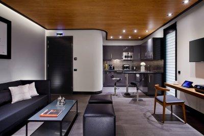 Metropolis Suite's Living Room & Kitchen